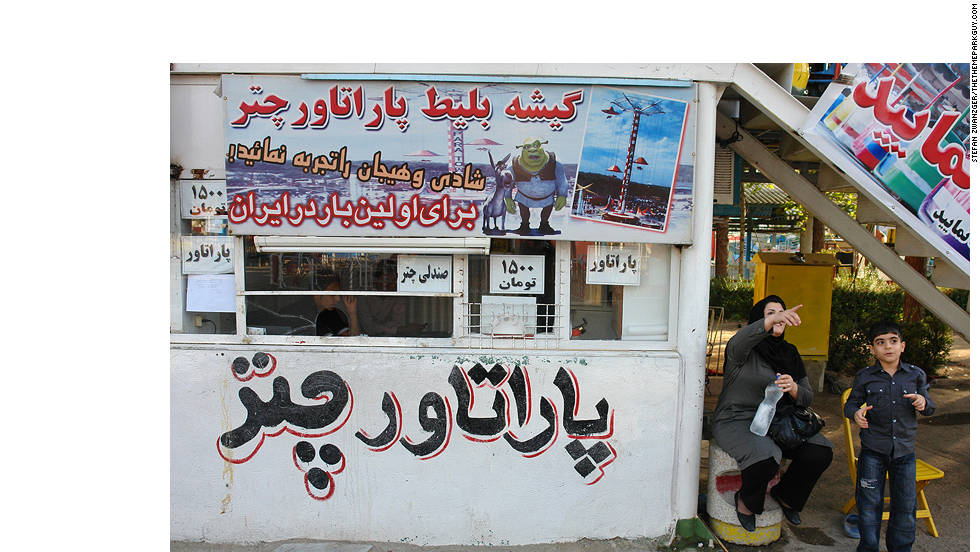 Even Shrek pops up to help sell tickets for Tehran's funfair rides.