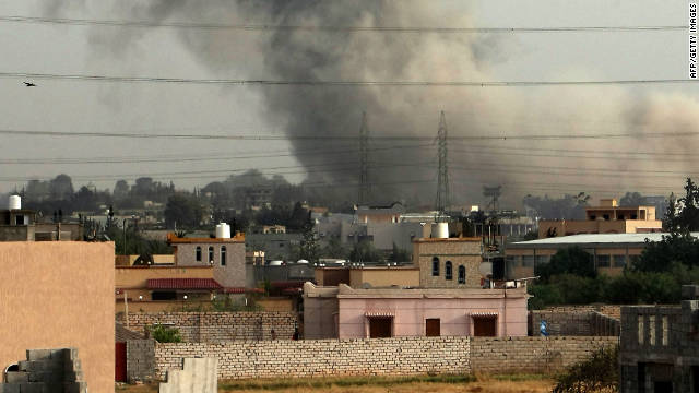 Smoke billows from a suburb of Tripoli on June 4, after NATO warplanes launched intensive air raids the capital.