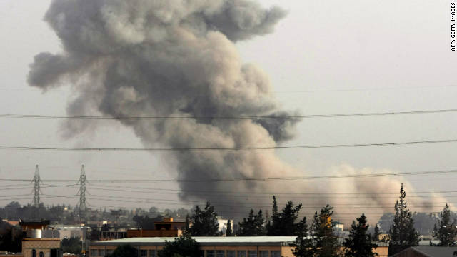 Smoke billows from Tajura, a suburb of the Libyan capital, Tripoli, in June after NATO warplanes launched air raids.