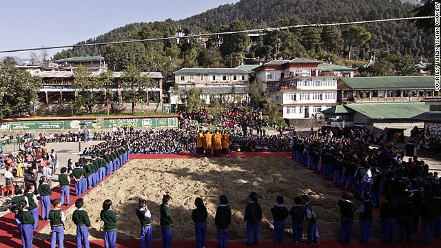 Tibetan exiles gather around soil from their native country that has been transported to India.