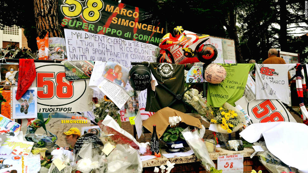 Mourners lay flowers in Marco Simoncelli's hometown of Coriano as a sign of their respect for the former Honda rider.