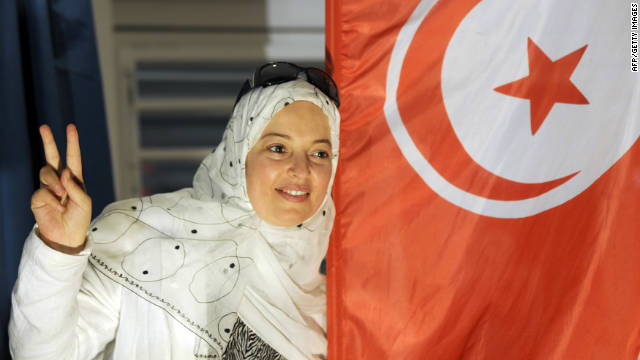 A supporter of Tunisia's Islamist Ennahda party celebrates on October 25 at party headquarters in Tunis.