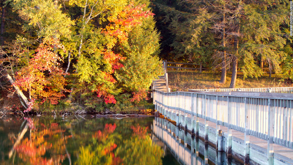 "Alanna St. Laurent shared this serene photo taken on Pete's Lake in Munising, Michigan. ""One of several inland lakes found in the Munising area, I captured this moment at sunrise with the fall color and white dock,"" she said."