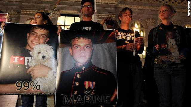 A vigil is held for Marine Lance Cpl. Scott Olsen, who was injured during an Occupy movement protest in California.