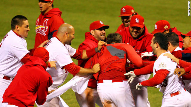 The St. Louis Cardinals celebrate their dramatic 10-9 win on Thursday.