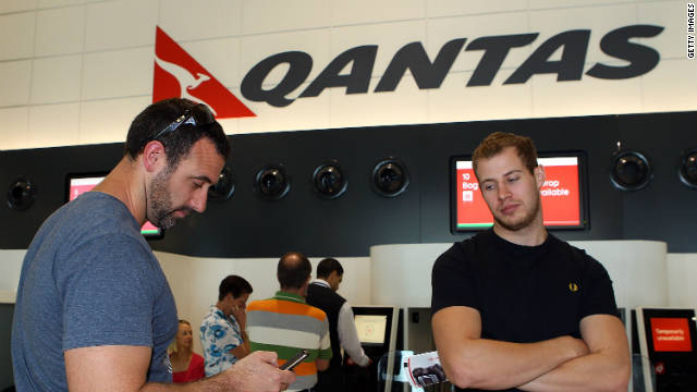 Passengers waiting to check in at Perth Airport on October 29, 2011, discover that Qantas flights have been grounded in an industrial dispute