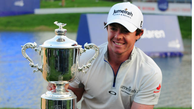 Rory McIlroy proudly shows off the Shanghai Masters trophy, which is accompanied by a cheque for a cool $2 million.