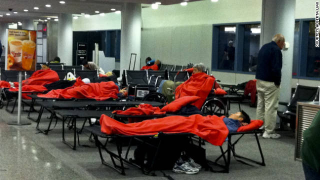 JetBlue passengers sleep on cots at Hartford, Connecticut's Bradley International Airport.