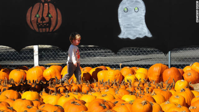 A child walks past pumpkins on display at a pumpkin patch in Culver City in southern California, ahead of Halloween.