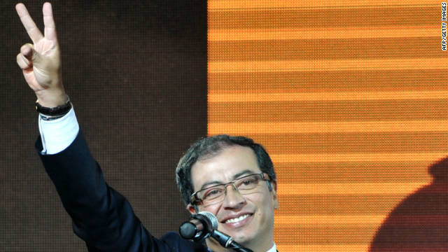 The leftist Gustavo Petro celebrates after being elected new mayor of Bogota, Colombia, on Sunday.