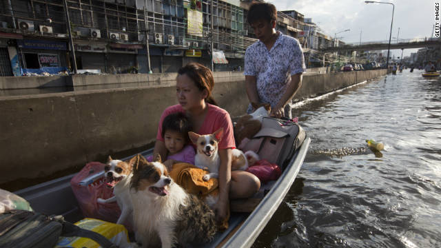 A Thai family evacuates from the capitol city.  Monsoon rains and swollen rivers have caused widespread flooding since June.