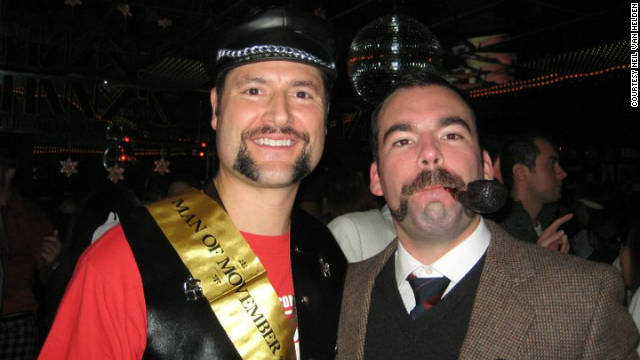 Neil Van Helden, right, proudly displays his mustache at last year's Movember event at Johnny's Hideaway in Atlanta.