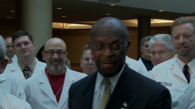 Cain lashes out at reporters