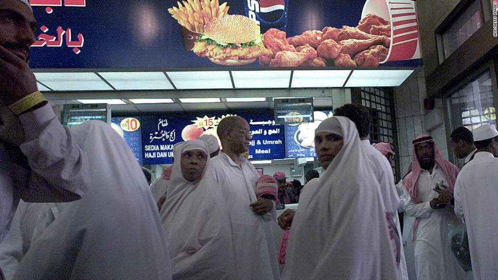 Pilgrims gather at a branch of the Kentucky Fried Chicken fast-food outlet in Mecca during the Hajj. The Green Pilgrimage Network seeks promote eating fairtrade and locally sourced food.
