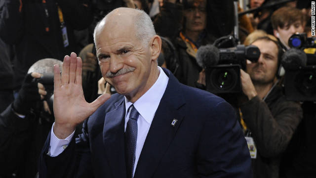 Greek Prime Minister George Papandreou waves as he arrives at the EU headquarters in Brussels, on October 26, 2011.