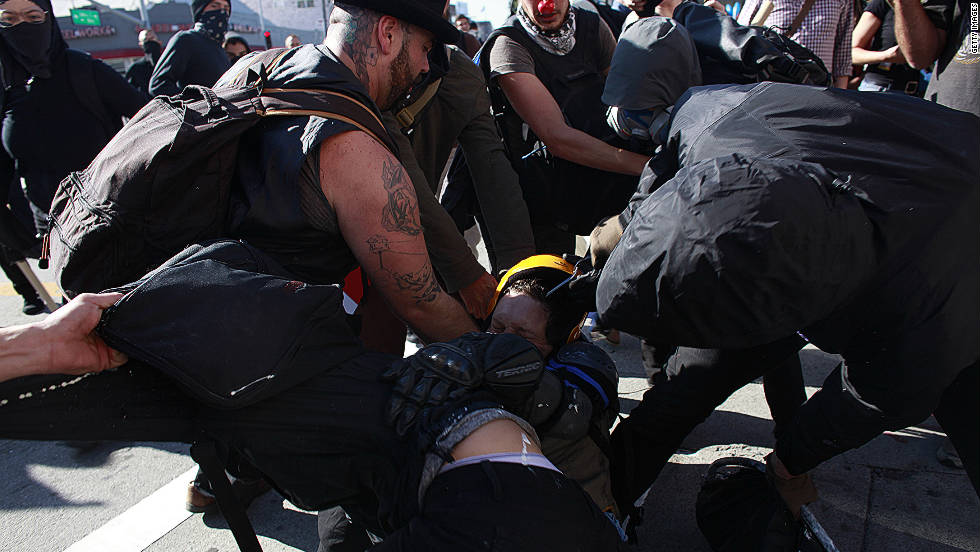Protesters clash during a demonstration  Wednesday in Oakland. Earlier, protesters carried out an apparently successful strike of downtown Oakland businesses.