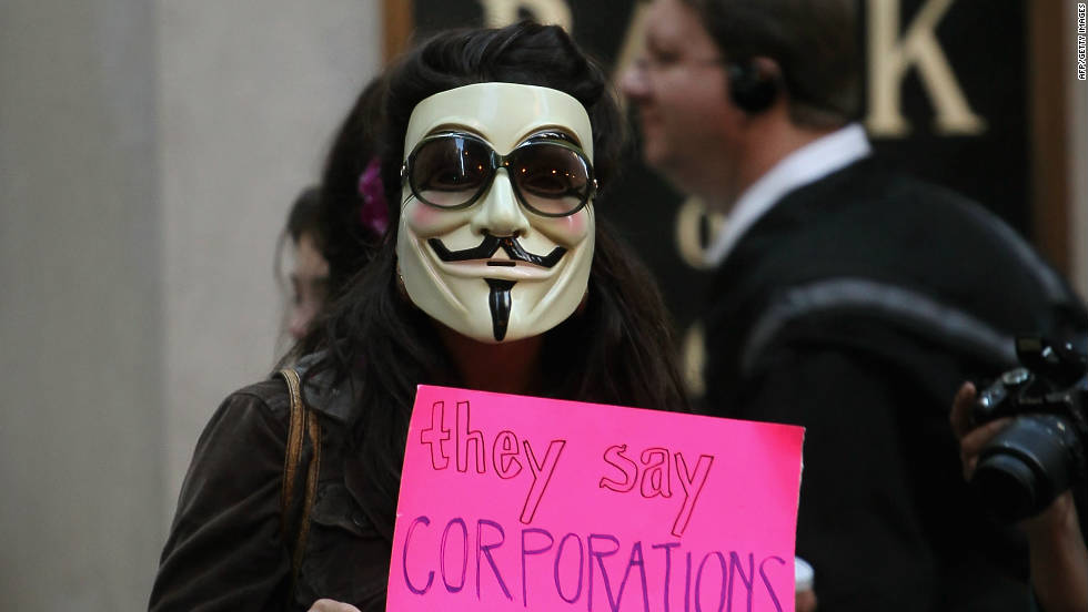 An Occupy demonstrator protests outside the Federal Reserve Bank on October 3 in Chicago.