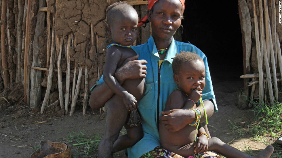 """Uri Betu is a foster mother for two mingi children: Tariqua, left, and Waiso, right. She says she tries not to think about the slow change to combat mingi killings. """"For now, we do not worry."""""""