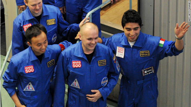 Members of the Mars500 crew Alexey Sitev of Russia smile for the press before being locked into the Mars500 isolation facility in Moscow on June 3, 2010.