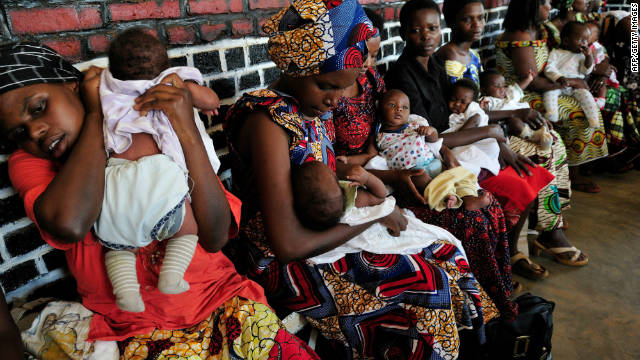 Rwandan mothers soothing their newborns after being vaccinated at a local clinic.