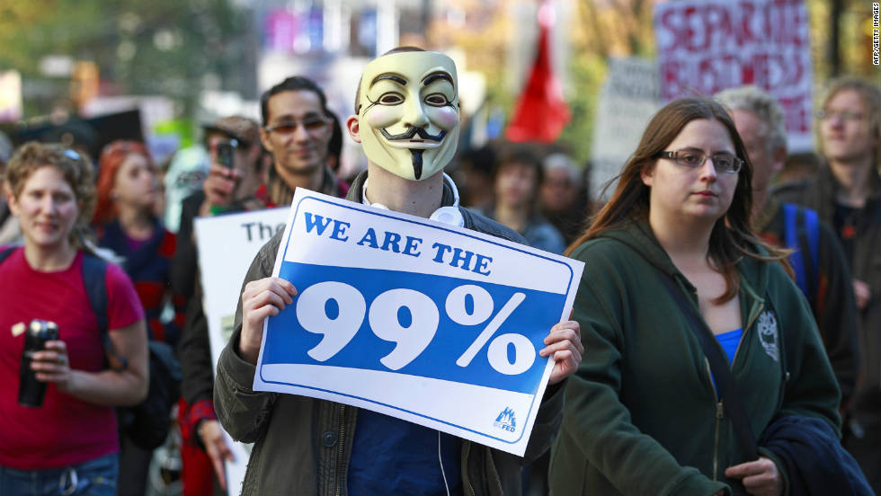 Another masked protester marches during Occupy Vancouver on October 15.