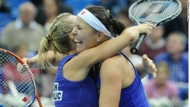 Lucie Hradecka (right) and Kveta Peschke celebrate their Fed Cup doubles success over Russia.