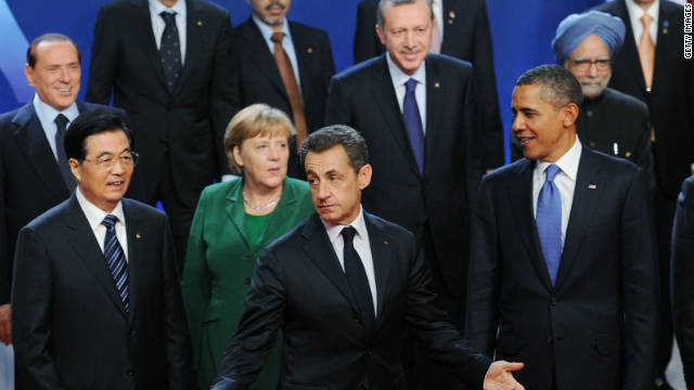 French President Nicolas Sarkozy gestures as German Chancellor Angela Merkel, U.S.President Barack Obama and China President Hu Jintao pose for a photo at the G20 Summit Thursday in Cannes, France.