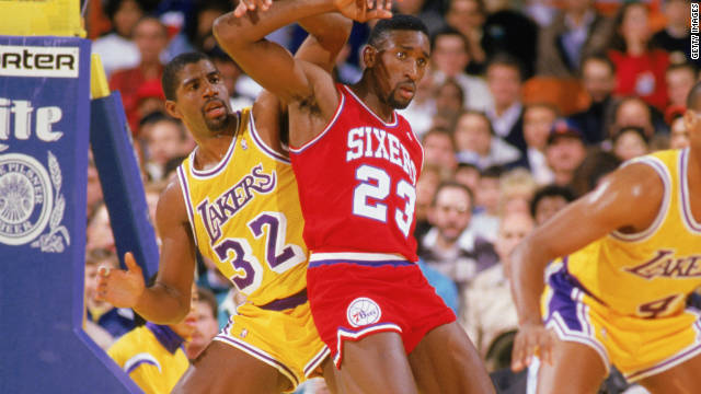 1987: Roy Hinson #23 of the Philadelphia 76ers boxes out Earvin 'Magic' Johnson #32 of the Los Angeles Lakers during the 1987-1988 NBA season