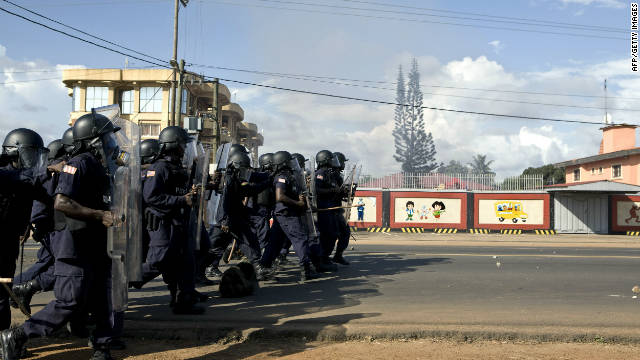 Liberian riot police surge a main thoroughfare during a rally in Monrovia on Monday.