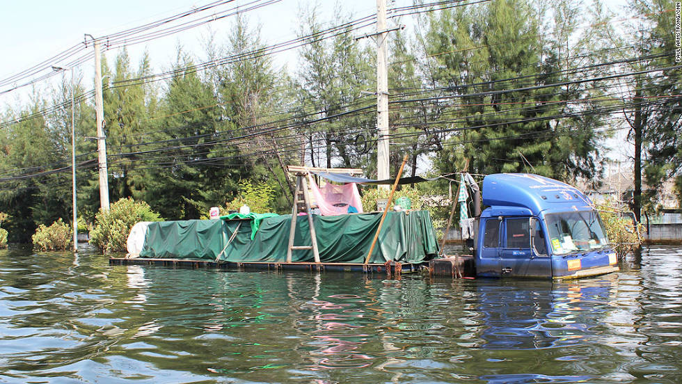 Some people have even set up a makeshift camp on the trailer of this partially-submerged lorry.