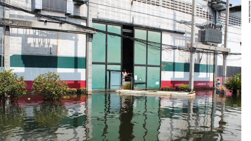 Like many businesses across Thailand, Romeo's factory is fighting to keep out the surrounding water.