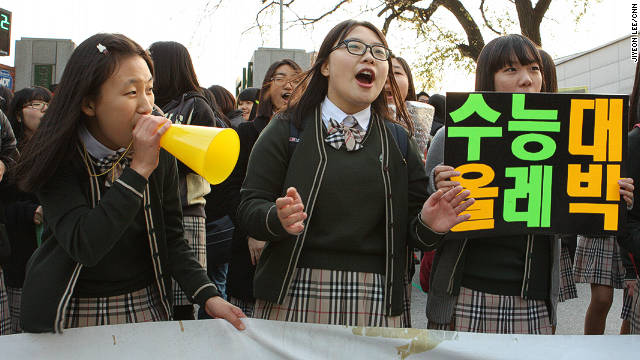 South Korean students cheer on their high school seniors who are taking their college entrance exams.