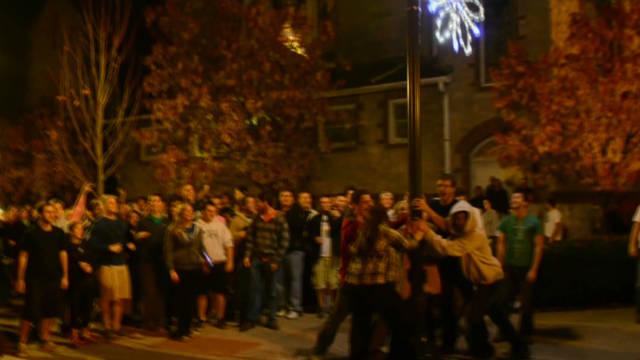 Angry Penn State students flip news van