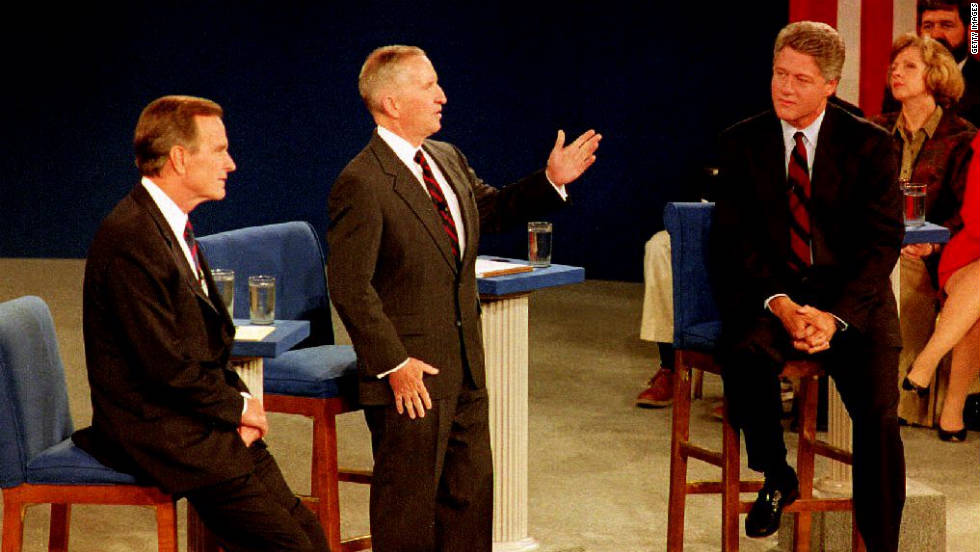 President George H.W. Bush checks his watch during a debate with Bill Clinton and Ross Perot on October 15, 1992.