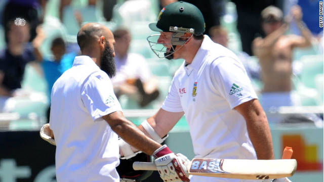 Captain Graeme Smith, right, congratulates Hashim Amla after his South Africa teammate passes three figures on Friday.