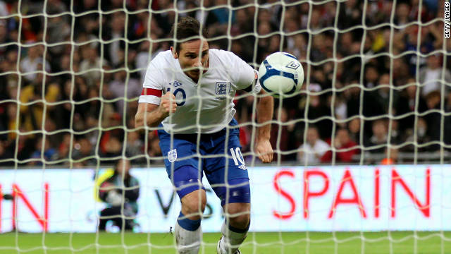 Frank Lampard stoops to head the only goal of the game for England at Wembley