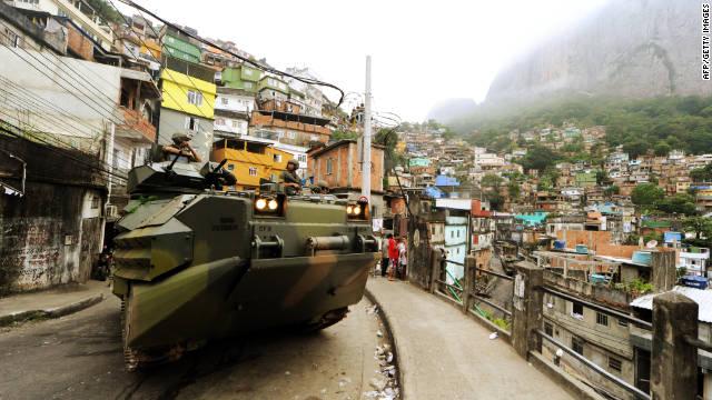 Marines drive an amphibious assault vehicle through the Rocinha shantytown on Sunday.