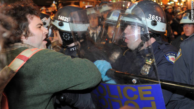 A man is confronted by New York Police Department officers as New York City officials clear the 'Occupy Wall Street' protest from Zuccotti Park in the early morning hours of November 15, 2011 in New York. The surprise crackdown at the birthplace of the movement, launched after similar evictions in other cities, signaled a tougher line by US authorities towards the two-month old protests against Wall Street and Washington elites. AFP PHOTO/Stan HONDA (Photo credit should read STAN HONDA/AFP/Getty Images)