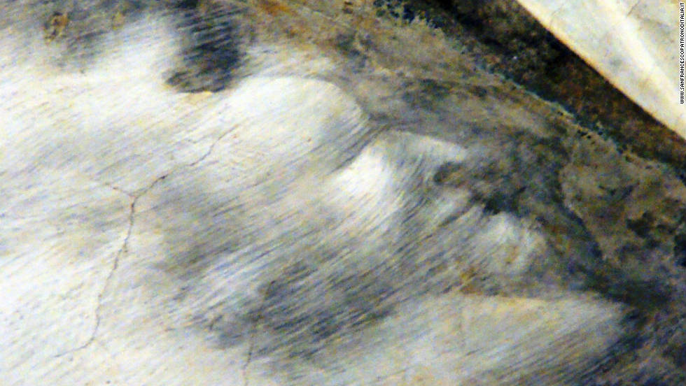 A detail of the devil's face discovered in the fresco.