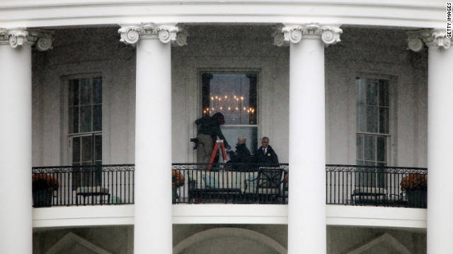 WASHINGTON, DC - NOVEMBER 16:  Law enforcement personnel investigate near the site where a bullet hit an exterior window on the south side of the White House November 16, 2011 in Washington, DC. The bullets are believed to have been fired last Friday after witnesses heard gunshots and saw two vehicles speeding away from the area.  (Photo by Win McNamee/Getty Images)