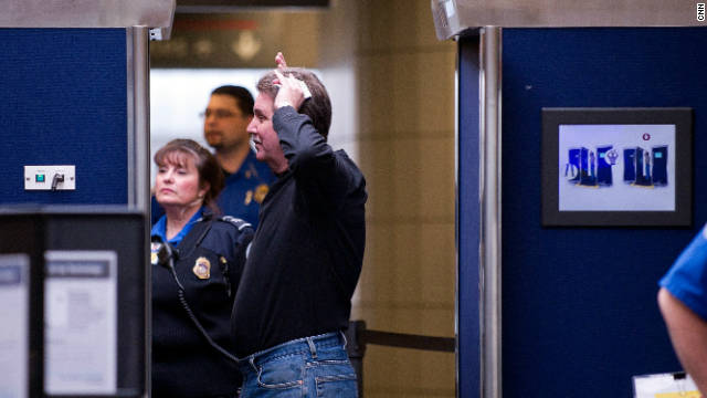 A male traveler submits to a full body scan before heading to his flight at Pittsburgh International Airport November 24, 2010.