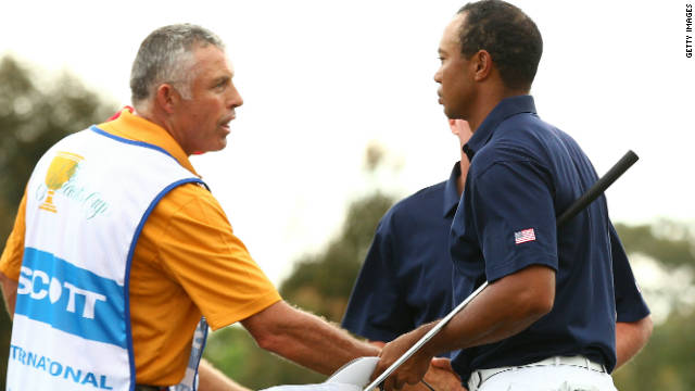 Tiger Woods and Steve Williams shake hands after the International pairing's comprehensive win in game six.