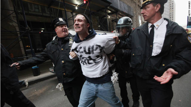 An occupy Wall Street protester is arrested by police a few blocks away from the New York Stock Exchange on November 17, 2011.