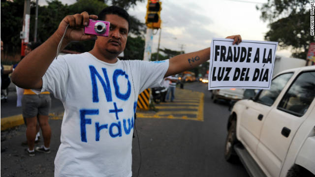 An opponent of Nicaraguan President Daniel Ortega takes part in a protest in Managua on November 9, 2011.