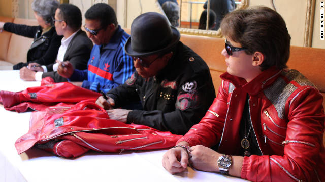 "Prince Jackson with uncles Jackie, Marlon, and Tito Jackson, signing special edition ""Beat It"" jackets."