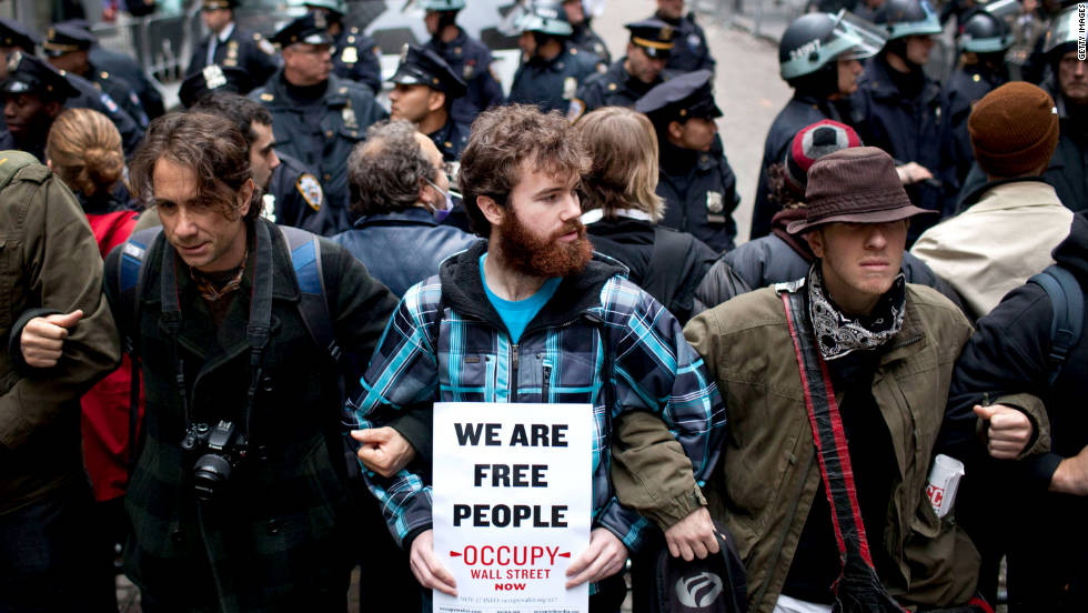 Occupy Wall Street protesters lock arms at an intersection in New York's Financial District.