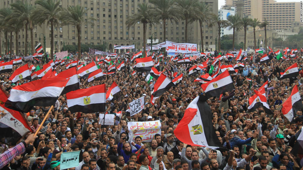 Tens of thousands of Egyptians wave national flags during a rally to protest against military rule in Cairo's Tahrir Square last November.