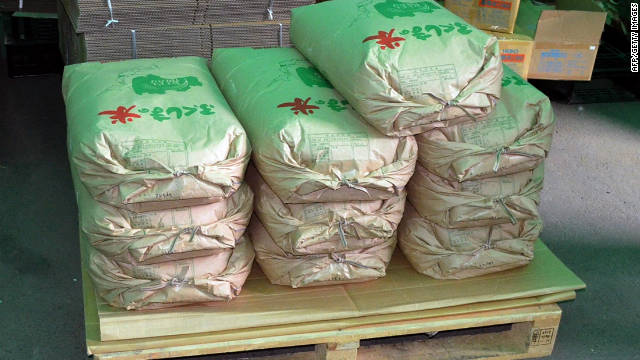 Contaminated rice bags are displayed in a warehouse in Fukushima city on November 17.