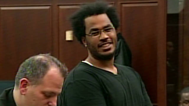 'Lone wolf' smiles as charges read