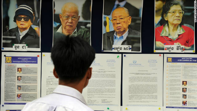 A Cambodian man looks at pictures of former Khmer Rouge leaders, three of whom are on trial.
